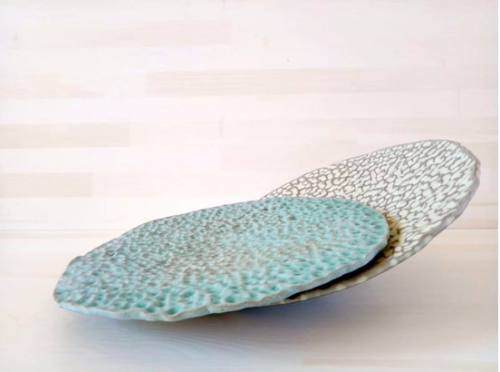 "Haroula Koropouli - Platters from Sfirilata (""Hammered"") series 2019 High temperature clay 1260 c, copper and tin glaze, 30 cm diameter."